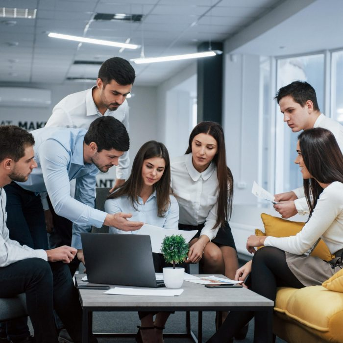 guy-shows-document-girl-group-young-freelancers-office-have-conversation-working-min-min